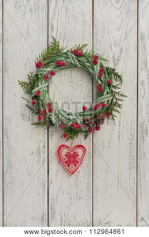 Christmas wreath over wooden background