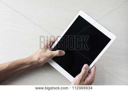 tablet like ipades computer isolated in a hand on the white backgrounds