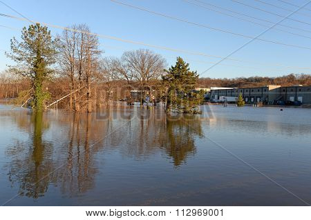 VALLEY PARK, MO/USA JANUARY 1, 2016: Flood waters near the Meramec River flood car and road signs in Valley Park, Missouri
