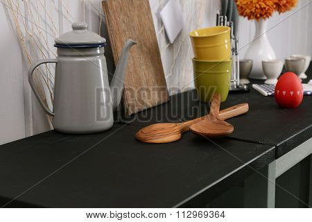 Kitchenware on table in the room
