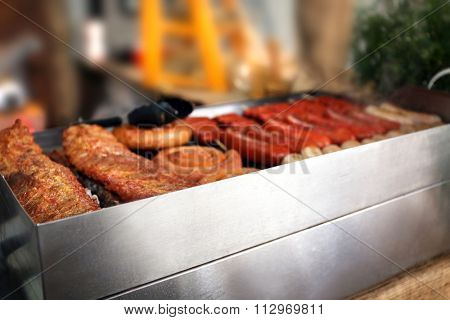 Smoked sausages on grill inside
