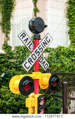 yellow railroad crossing sign