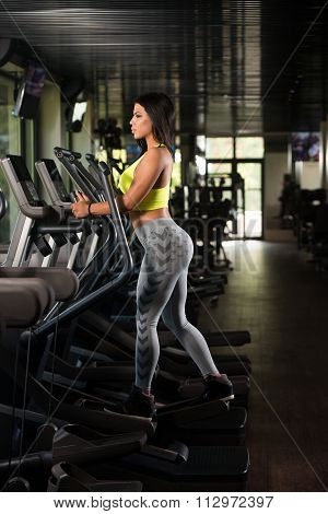 Mexican Women On Elliptical Treadmill In Fitness Gym