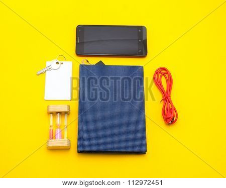 Blue Book With Smart Phone Object Key Usb Cable On Yellow Paper