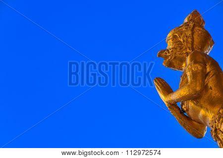 Golden Garuda Statue With Blue Background