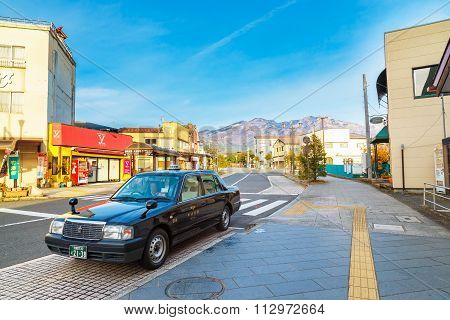 NIKKO JAPAN - NOVEMBER 17 2015: An unidentified Japanese taxi cab parks his car in front of Tobu - Nikko Station waits for passenger