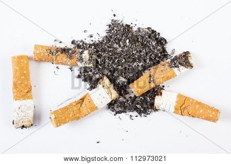 Cigarette Butts And Ash On White Background