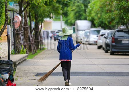 Worker Cleaning Street
