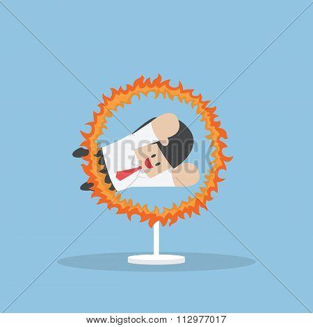 Businessman Jumping Through The Fire Hoop