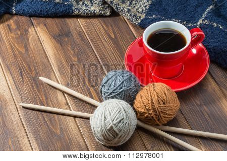 Ball Of Wool And Coffee On Wooden Floor