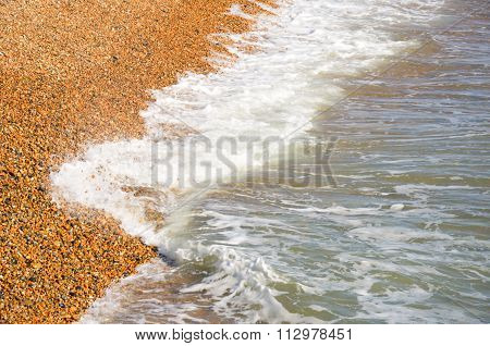 Waves on shingle