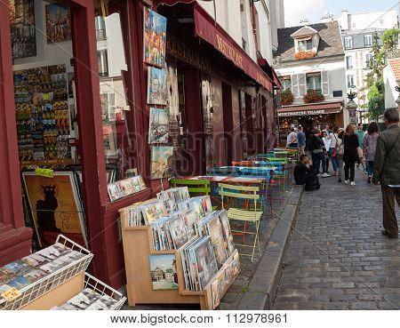 PARIS, FRANCE - SEPTEMBER 10, 2014: Paris - Very colorful Parisian outdoor cafe in Montmartre