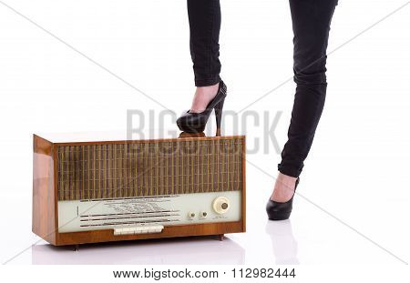 Female Foot Was Stepped On An Old Radio