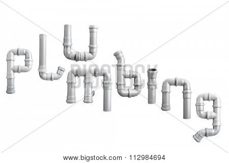 Plumbing word arranged from different PVC piping elements shot on white