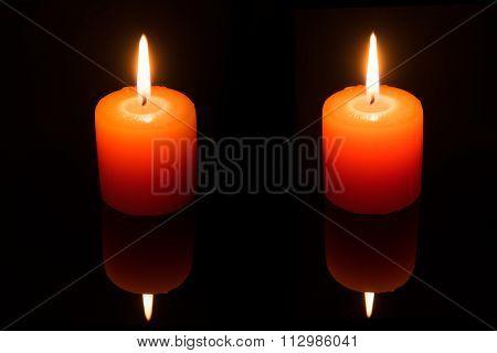 Light Couple Candle On Black Background