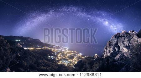 Beautiful Night Landscape With Milky Way Against City Lights