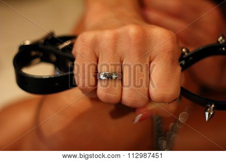 Dominant woman holding a coller in her hand