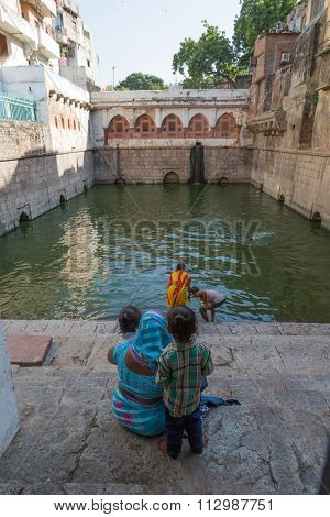 Purifying In The Nizamuddin Dargah, Delhi, India