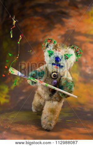 Multicolor Paintbrush In Hand Of A Wizard Teddy Bear