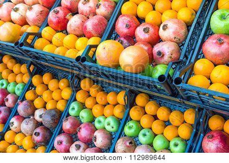 Pomegranates, apples and oranges