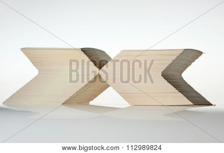 X-sign Formed By Cards Stacks