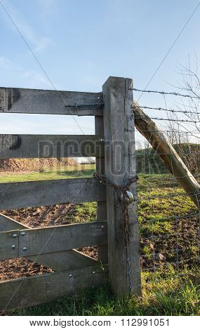 Part Of A Closed Wooden Gate In A Rural Landscape