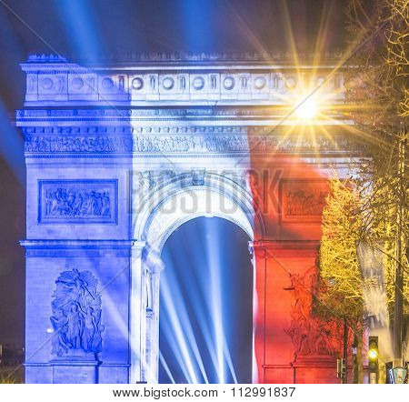 The Triumphal Arch Lit Up With The Colors Of French Flag.