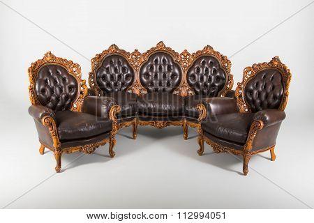 Vintage Sofa With Armchair Studio Shot.