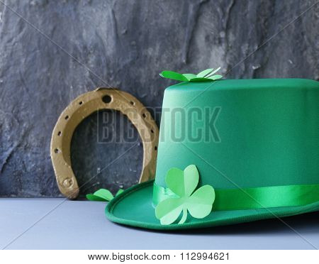 traditional symbols for Patrick's Day - green hat, horseshoe and clover