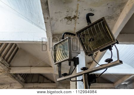 Floodlights Attached To A Steel Frame. Horizontal View Of Yellow Floodlights Attached To A Frame, Us