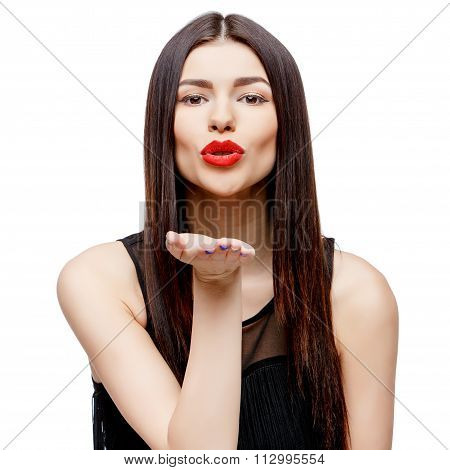 Attractive beautiful woman showing air kiss
