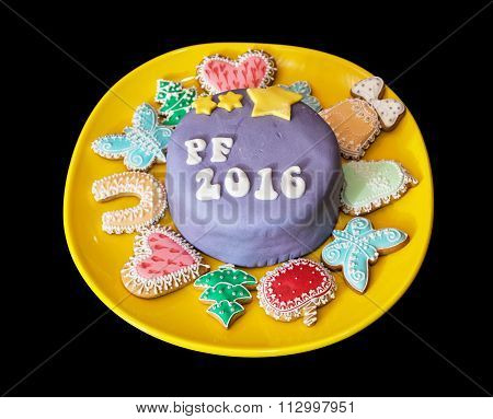 The Title Pf 2016 Written On Festive Cake With Various Gingerbread Cookies