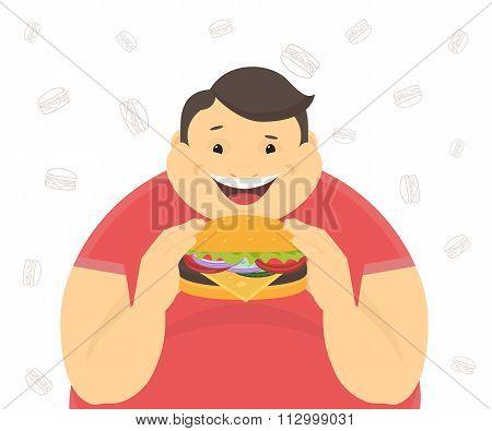 Happy fat man eating a big hamburger