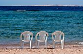 Three Chairs On The Beach
