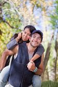 stock photo of native american ethnicity  - Young multi ethnic couple in autumn forest - JPG