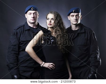 Fashion photography of a beautiful young lady and her bodyguard