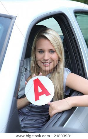 Blond teenage learner driver