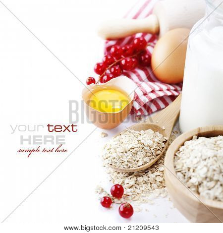 Fresh ingredients for oatmeal cookies (oat flakes, eggs, milk, fresh ripe currant) over white with sample text