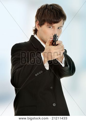 Businessman aiming with handgun.
