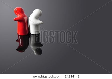 Two Figures Turning Theirs Backs At Each Other