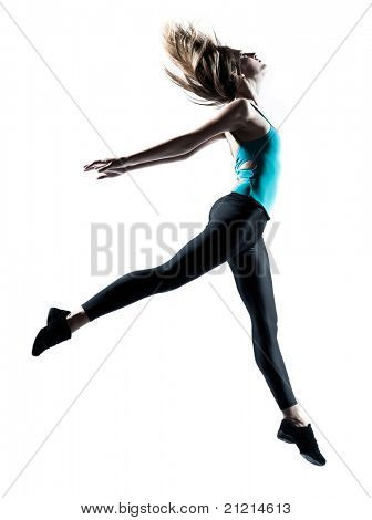 Side view of a sporty young woman jumping isolated on white background