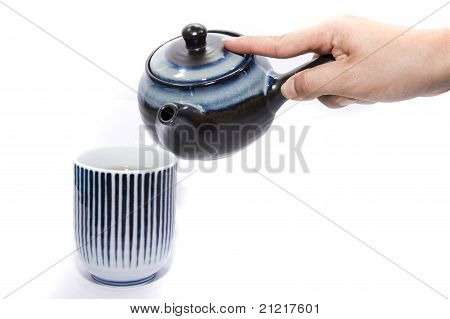 hand and tea isolated