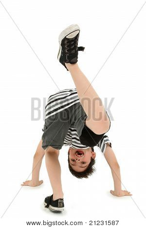 Boy Doing Cartwheel Over White Background