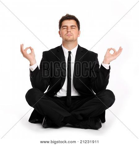 A picture of a young businessman practicing yoga over white background