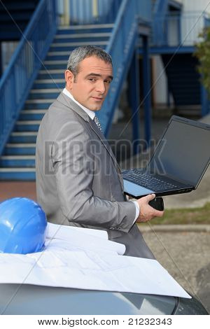 Architect with a laptop computer