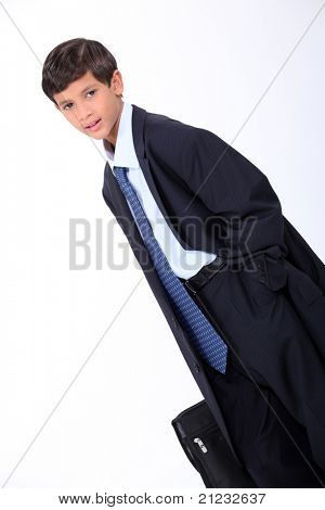 Young boy in his father's business suit