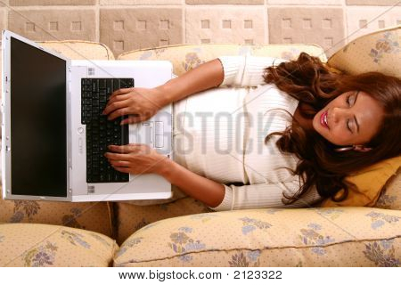 Model Working With Laptop In Her Home