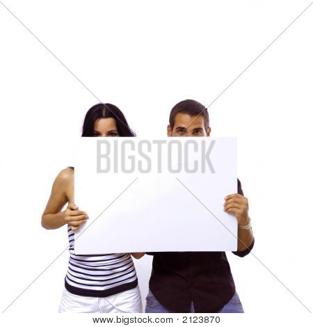 Teen Couple Holding Blank Banner
