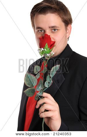 Young Man Smelling Rose