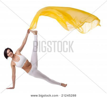 woman exercise yoga pose with yellow flying veil